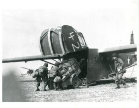 US soldiers unload a glider plane after landing near Wesel.