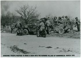 Airborne troops prepare to make a dash into the burning village of Hamminkeln. March 1945.