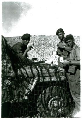 Three members of 3 PARA with their mess tins in the Canal Zone.