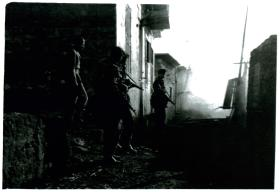3 PARA clearing the village of Gaynaeim, following trouble from snipers, Canal Zone, Egypt, 8/12/51.