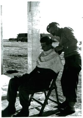 Member of 3 PARA gets a haircut, Shandur camp, Canal Zone, 3/1/52.