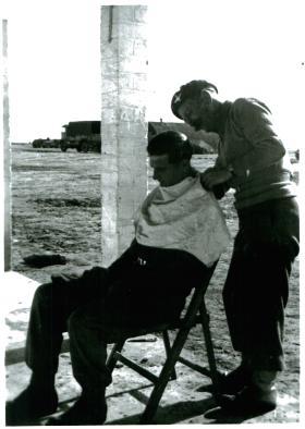 Member of 3 PARA gets a haircut, Shandur camp, Canal Zone, 3/1/52.