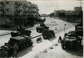 Armoured cars of 6th AB Div await orders to begin patrols in Tel Aviv.