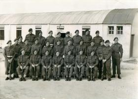 Group photo of 3rd Parachute Battalion outside billets in Palestine.