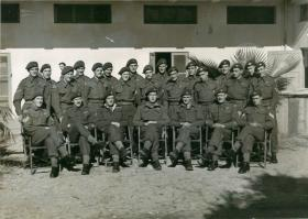 Group shot of B Company, 8th Parachute Battalion outside billets in Palestine.