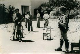Paratroopers guard a huge arms cache found in a school basement in Tel Aviv.