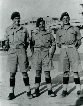 One paratrooper and two RAMC soldiers pose for the camera in Palestine, 1946.