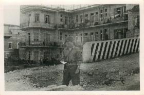 Airborne soldier reads IZL pamphlet found in waste ground in Haifa, 1948.