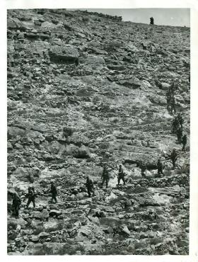 3 PARA soldiers move across typically difficult terrain in the Radfan mountains, May 1964.
