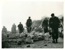 Paratrooper section moves forward under fire from tribesmen, Radfan 1964.