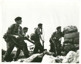 Company commander calling for fire support while under fire, Radfan 1964.