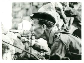 Major Mike Walsh OC A Coy 3 PARA observing for enemy while under fire, c1964.