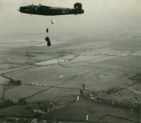 Halifax bomber dropping Jeep and containers during a practice run near Netheravon, 1946-47.