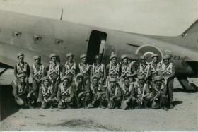 No 1 Stick, A Company, 15th Battalion in front of a C-47, India, c. 1946.