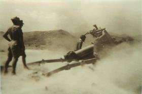 Members of 3rd Royal Horse Artillery firing gun, Thumier Airfield, Aden, 1964