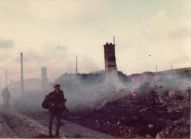 British Paras enter the still burning Port Stanley.