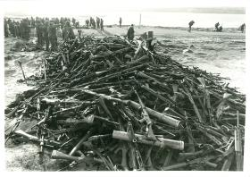 Pile of captured Argentinian weapons outside settlement of Goose Green.