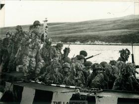2 Troop, 9 Parachute Squadron RE come ashore Port San Carlos, 21 May 1982.