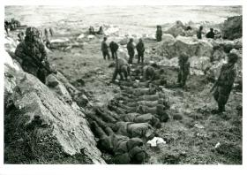 Argentinian prisoners are secured and searched at Mount Longdon, June 1982.