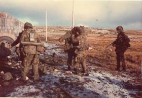 Captain Adrian Freer`s Support Group, A Company, 3 PARA search prisoners moving into Port Stanley, 14 June 1982.