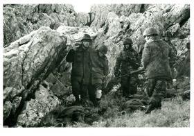 Members of 3 PARA marshalling Argentinean soldiers at Mount Longdon, 12 June 1982.