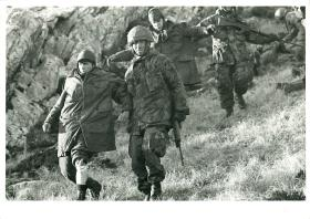 Argentinian prisoners are led away on Mount Longdon.