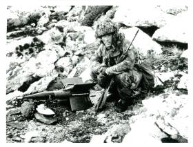 Sgt Graham Colbeck, 3 PARA, examines anti-tank missile on Mount Longdon.