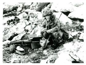Sgt Graham Colbeck, 3 PARA, examines anti-tank missile on Mount Longdon.