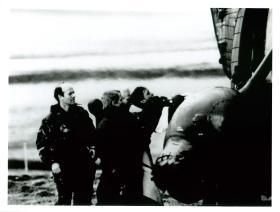 Padre David Cooper supervises casualty evacuated by helicopter.