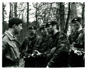 Prince Charles talks to four armed members of the Parachute Regiment