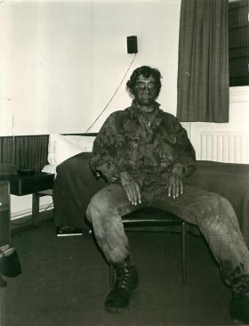 Captain Simon Barry relaxes after an operation.