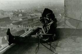Paratrooper on a rooftop observation post.