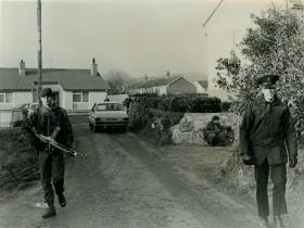 Pte Scarratt (left) and Pte Gibson on joint operation with member of the Royal Ulster Constabulary.