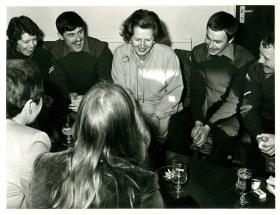Margaret Thatcher talks to troops around a table during a visit early on in the troubles.