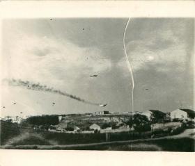 German JU52 transport plane  on fire from ground troops, Crete.