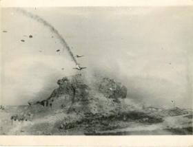 German parachutists landing and a Ju52 on fire, Crete.