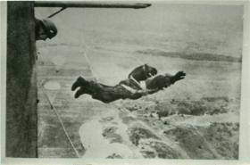 German paratrooper on exit from the aircraft.