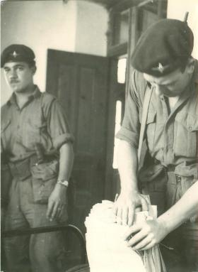 Two paratroopers tackle some paperwork in Cyprus, 1956.