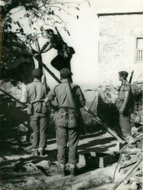 Paratroopers search for arms and ammunition in Cyprue, 1956.