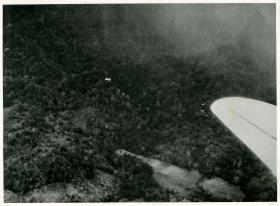 Photo of exercise in Malaya. Sticks of men over shoot drop zone.