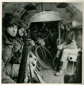 Men of 249 Field Company sit in glider with bicycles.