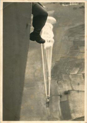 Parachutist exiting a Douglas Dakota during a training jump in India