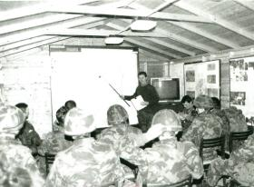 Paratroopers attend a pre-operation briefing.