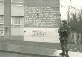 Graffiti on a building wall giving the Irish view of many emergency tours.