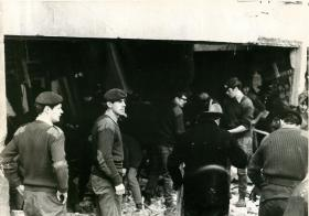 Paratroopers including Captain Graham Gilbert, adjutant fo 3 PARA clean up IRA bomb damage at Aldershot.