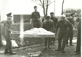 A body is removed from the bombed Officers' Mess at Aldershot barracks.