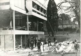 The destruction done to the Officers' Mess by an IRA bomb can be seen.