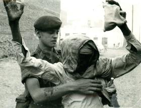 A Paratrooper conducting a stop and search, Aden, 1967