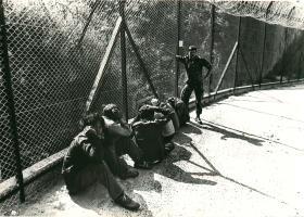 Refugees apprehended at the border and awaiting transportation, Hong Kong, 1980