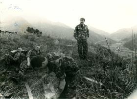B Company 1 PARA pause on a grassy slope before patrolling, Hong Kong, 1980